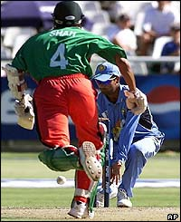 India's Zaheer Khan reaches for a stumping as Kenyan opening batsman Ravindu Shah runs for the crease