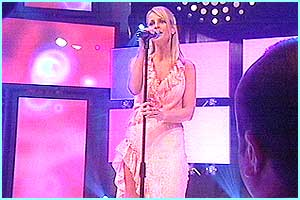 A very nervous Ulrika was up first - she sang You Don't Bring Me Flowers in quite a shaky voice!