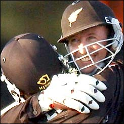 Chris Harris hugs Nathan Astle in jubilation as New Zealand celebrate their win over Zimbabwe in the Super Six stage
