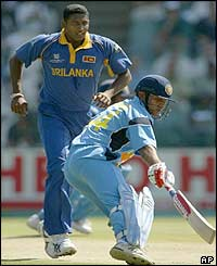 Sri Lanka's Prabath Nissanka watches as Virender Sehwag turns to set off for another run