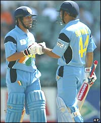 Sachin Tendulkar and Virender Sehwag punch hands in celebration at hitting another four