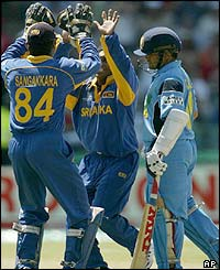 Sri Lankan bowler Aravinda de Silva celebrates taking the wicket of Sachin Tendulkar
