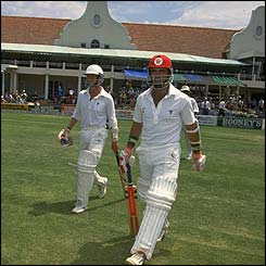 Andy Flower walks out to bat in  Zimbabwe's first ever Test match in 1992