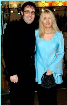New husband Neil Murray and JK go arm-in-arm to the premiere of Philospher's Stone in 2001