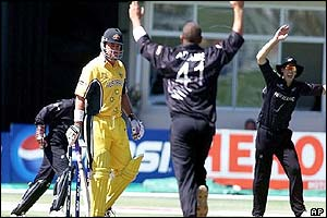 Australia's Darren Lehmann walks after he was dismissed by New Zealand bowler Andre Adams