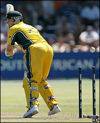 Australia's Ian Harvey is bowled by New Zealand's Shane Bond