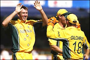Glenn McGrath does a high-five with wicketkeeper Adam Gilchrist as he celebrates taking two early New Zealand wickets