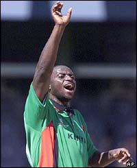 Kenyan bowler Tony Suji succesfully appeals for the wicket of Zimbabwe's Alistair Campbell