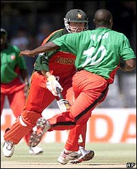 Alistair Campbell scampers through for a single as Kenyan bowler Tony Suji fields