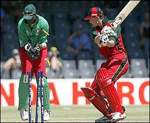 Zimbabwe's Doug Marillier is bowled out by Kenya's Steve Tikolo