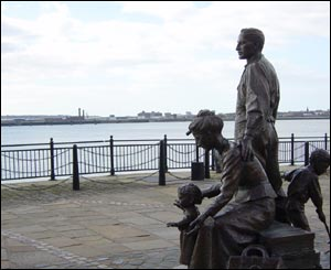 Bronze statue on the banks of the Mersey
