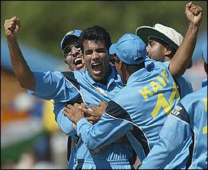 India's Zaheer Khan celebrates claiming the wicket of New Zealand's Nathan Astle