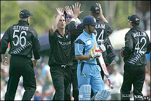 Shane Bond is congratulated by team-mates after taking the wicket of Virender Sehwag