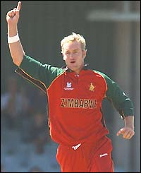 Zimbabwe's Sean Ervine raises a finger in celebration after dismissing Aravinda de Silva