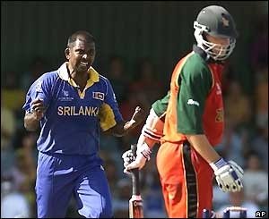 Pulasthi Gunaratne celebrates bowling Travis Friend for 21