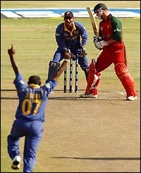 Sanath Jayasuriya celebrates as Craig Wishart is bowled