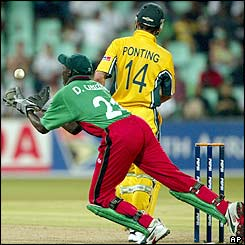 Australia captain Ricky Ponting departs lbw while Kenyan David Obuya scoops up the ball