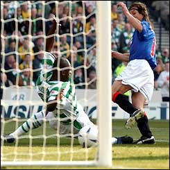 Claudio Cannigia beats Bobo Balde to the ball and scores for Rangers
