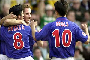 Rangers winger Peter Lovenkrands is congratulated on his goal