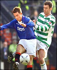 Rangers' Barry Ferguson gets to the ball ahead of Celtic's Chris Sutton