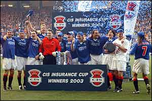 Rangers players celebrate retaining the CIS Cup