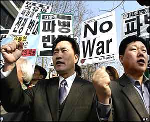 Protesters shout slogans during an anti-war rally in front of presidential palace in Seoul
