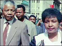 Nelson and Winnie Mandela leave court after the guilty verdict