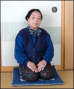 Echio Sato on traditional mats in front of sliding doors
