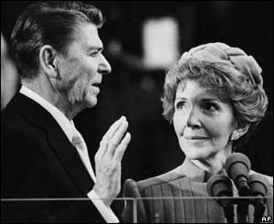 Nancy Reagan proudly watches as her husband Ronald Reagan takes the oath of office at the Capitol