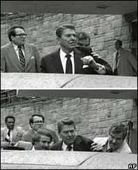 Reagan is pushed into his car by Secret Service agents