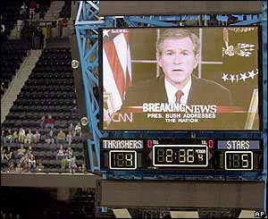 US President George W Bush  seen on giant TV screen at a hockey match in Atlanta