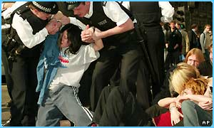 Police remove schoolchildren protesting in London's Parliament Square