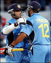 Sourav Ganguly is embraced by Yuvraj Singh after scoring his century