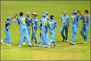 India celebrate taking another Kenyan wicket