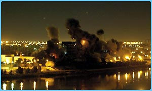 Smoke billows over the Ministry of Planning which was hit by a missile in Baghdad