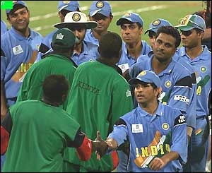 The Indian players commiserate with the losing Kenyan team