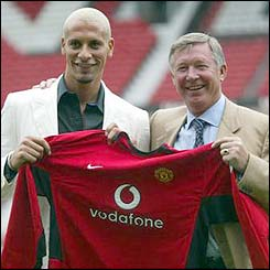 Rio Ferdinand and Sir Alex Ferguson after Ferdinand  is sold to Man Utd in a £30m deal