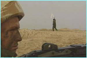 Many Iraqi soldiers are giving in, like this man, surrendering with a white flag