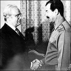 UN Secretary General Javier Perez de Cuellar shakes hands with Saddam Hussein in September 1987