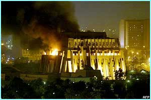 A building in one of Baghdad's presidential palace quarters is hit