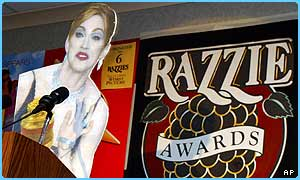A cardboard cut-out of Madonna 'accepts' her Razzie award