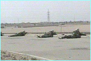 Coalition troops try to take the important port of Umm Qasr in Iraq