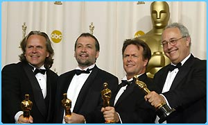 The special effects team: Jim Rygiel, Joe Letteri, Randall William Cook and Alex Funte pose with their Oscars