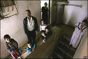 Iraqi family hide in their home to avoid bombardment and pollution