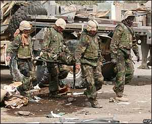 US marines carry body of fellow marine killed after alleged ambush by Iraqi troops in the southern city of Nasiriya