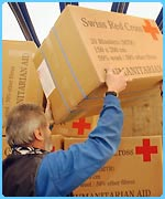 Swiss Red Cross pile up boxes of blankets which will go to Iraq