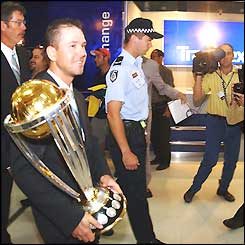 Ricky Ponting carries the World Cup through Perth airport
