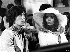 Mick and Bianca seated in a church pew
