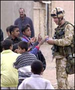 British Marine giving sweets to Iraqi children