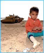 A child sits in front of a tank in Basra